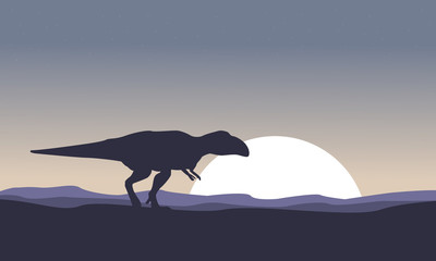 Illustratrion of mapusaurus at night scenery silhouettes