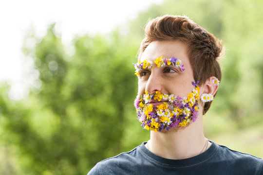 portrait of a guy with flowers instead of his beard