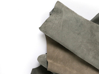 pieces of natural leather in gray isolated on white background