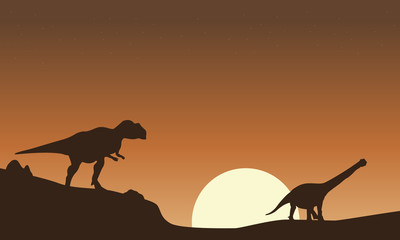 Silhouette of mapusaurus and argentinosaurus scenery