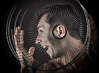 Man listening from the birdcage, concept