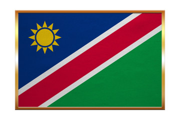 Flag of Namibia , golden frame, fabric texture