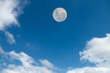 Moon and clouds at daytime