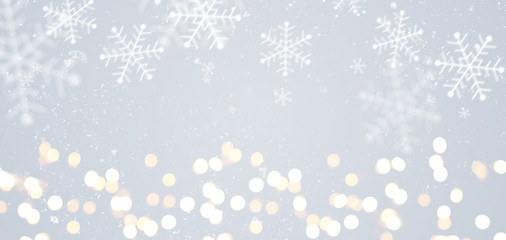 Grey festive Christmas or New Year background with shiny golden baubles