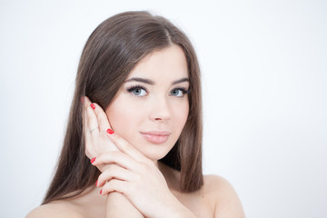 Beautiful Young Woman with Fresh Clean Skin touch own face. Cosmetology, beauty and spa.