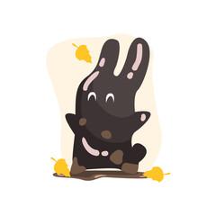 Black Tar Jelly Rabbit Shape Monster Smiling Under Falling Yellow Leaves Outdoors In Autumn Season