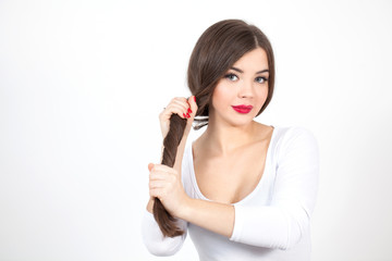 Beautiful Young Woman with Fresh Clean Skin touch own face. Healthy beautiful hair, red lips, Cosmetology, beauty and spa.