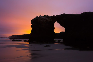 Natural arch at  As Catedrais beach in  sunrise