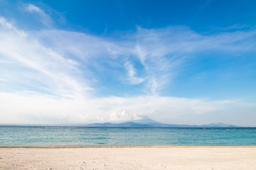 Amazing tropical beach with white sand, blue sky and beautiful ocean. Tropical island Nusa Lembongan, Indonesia.