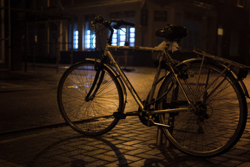 Bicycle on the night rainy street in Ostend, Belgium