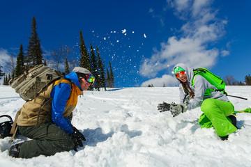 Snowboarders Couple enjoy the ski resort of rushing snow
