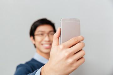 Asian man makes selfie