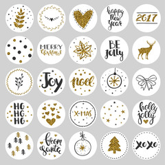 Set of round Christmas stickers. Christmas labels and stickers for decorating presents for winter holidays. Black and gold round stickers with glitter.