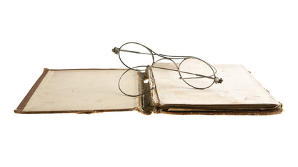very old book and glasses