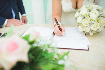 Bride with Pen and Bouquet