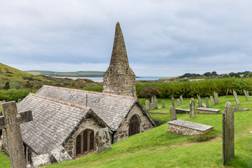 The Church of St Enodoc is located amongst sand dunes adjacent to the Cornish village of Trebetherick.