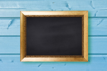 Chalkboard in vintage frame on blue wooden wall texture