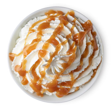 Bowl of whipped cream and caramel sauce