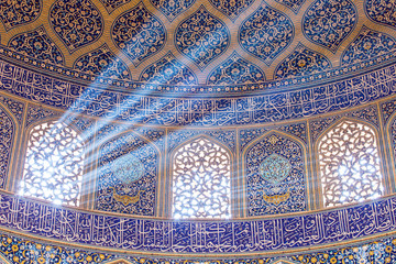 Isfahan, Iran - December 13, 2015: Sheikh Lotfollah Mosque at Naqhsh-e Jahan Square in Isfahan, Iran. Ceiling view