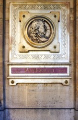 Plaque representing French playwright Pierre Corneille on the wall of the Comedie Francaise theater (aka Theatre Francais) in the Palais Royal in Paris