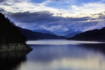 Landscape with dam lake Vidraru in Romanian mountains, in the wi