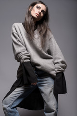 Portrait of skinny woman in stylish oversized clothes
