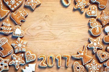 Homemade Christmas cookies on wooden background. Copy space for your text.