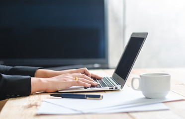Woman working with computer at home or at office
