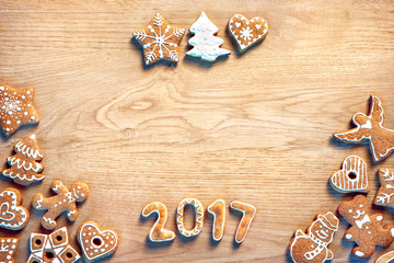 Merry Christmas and Happy new year! Homemade cookies on wooden background. Top view.