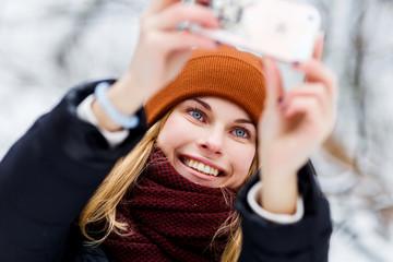 Woman in hat making selfie
