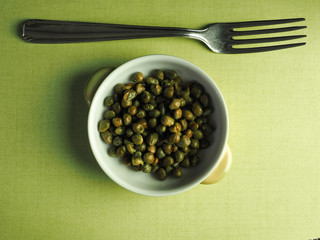 Capers in a bowl wih a fork