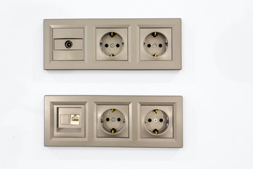 electrical outlets input for TV and Internet