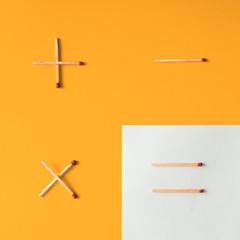 Matches arranged on orange background