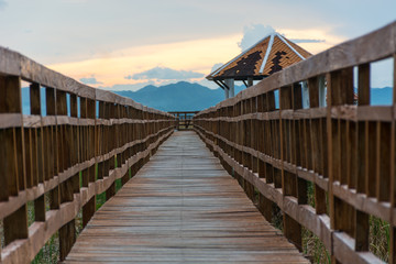 Sunset long wooden bridge in Sam Roi Yot National Park ,Prachuap