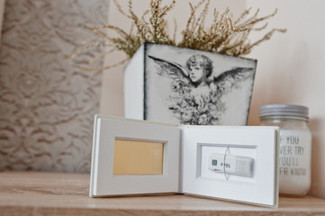 White classic photo flash box of flash drive inside on 16 GB USB