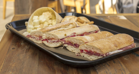 Tray with jamon sandwiches and cheese cubes, Spanish tapas