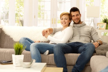 Portrait of attractive young couple at home