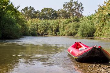 Red inflatable boat, Jordan River