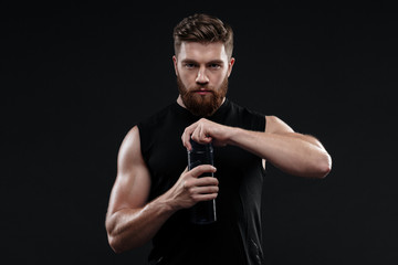 Athletic man with bottle