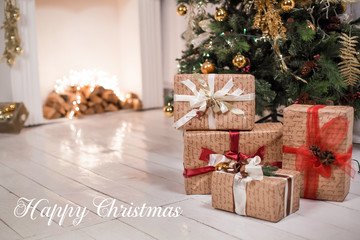 decorated chrismas room with a tree,presents,fireplace