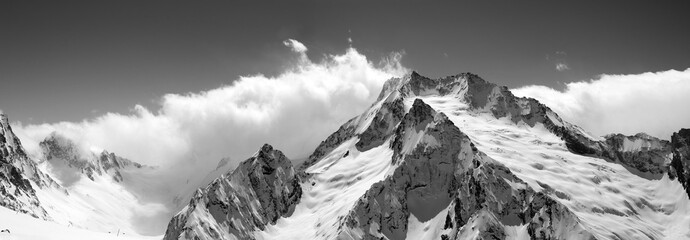 Black and white mountain panorama in clouds