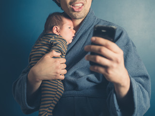 Father taking selfie with baby