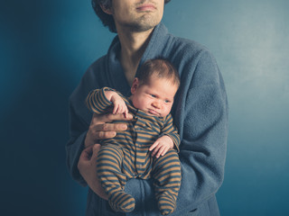 Father holding his baby son