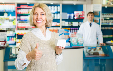 Female customer in pharmacy drugstore  .