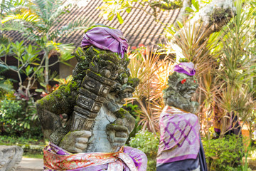 Traditional demon guards statue in temple Ubud on Bali island, Indonesia