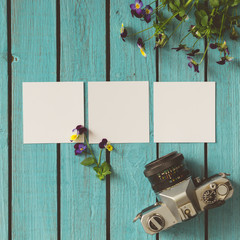 Three blank photos on wooden summer background
