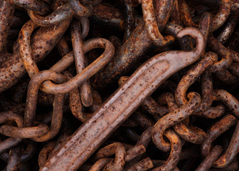 Old and rusted clasp hook and chains.