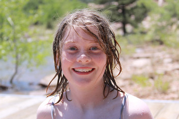 young girl with wet hair smiling