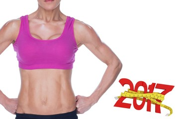 Composite image of female bodybuilder posing in pink sports bra