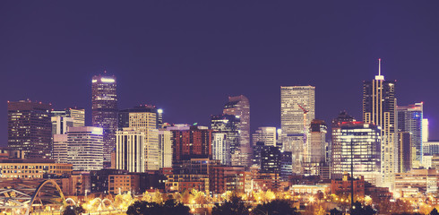 Vintage toned Denver downtown skyline at night, USA.